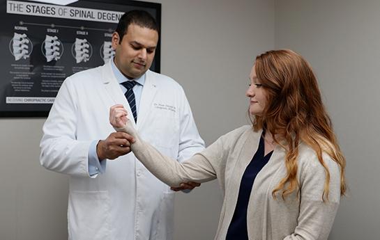 Chiropractor Coral Springs FL Dr. Maan Dhanjal Exam